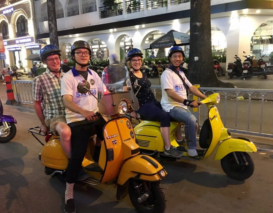 Mr. and Mrs. McCarthy on their way to explore Saigon by night on the back of a vintage Vespa
